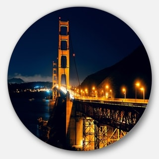 Designart 'Golden Gate at Night' Sea Bridge Round Metal Wall Art