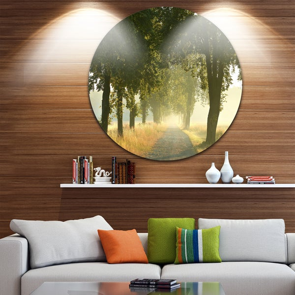 Designart 'Rural Road Under Big Green Trees' Landscape Photo Circle Wall Art