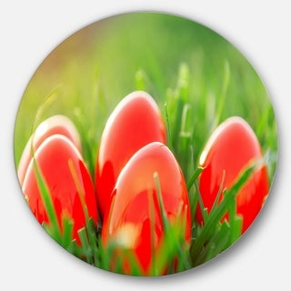 Designart 'Red Easter Eggs in Green Grass' Landscape Photo Round Metal Wall Art