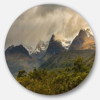 Designart 'Green Mountains under Stormy Clouds' Landscape Round Metal Wall Art