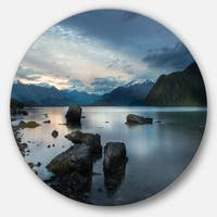 Designart 'Rocks and Distant Cloudy Mountains' Landscape Round Metal Wall Art