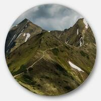 Designart 'Trekking Patch in Tatra Mountains' Landscape Large Disc Metal Wall art