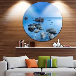 Designart 'Rocky Blue Sea' Seascape Photography Round Wall Art
