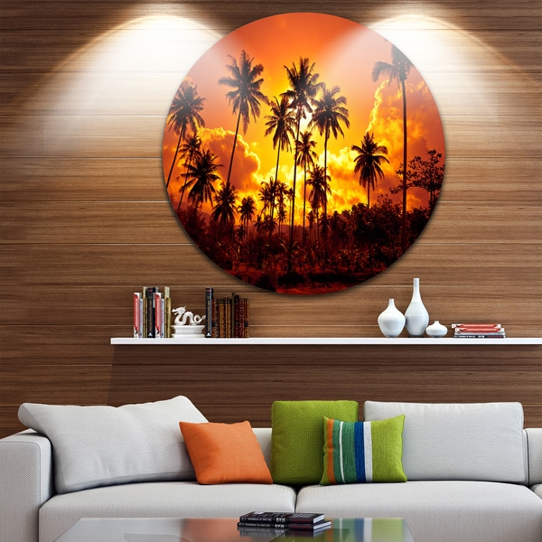 Designart 'Coconut Palms Against Yellow Sky' Landscape Photo Disc Metal Wall Art