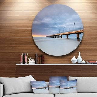Designart 'Long Concrete Pier into Sea' Sea Bridge Circle Wall Art
