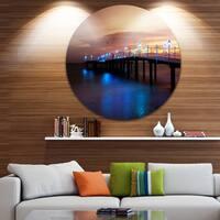 Designart 'Blue Waters and Bridge at Sunset' Sea Bridge Round Wall Art