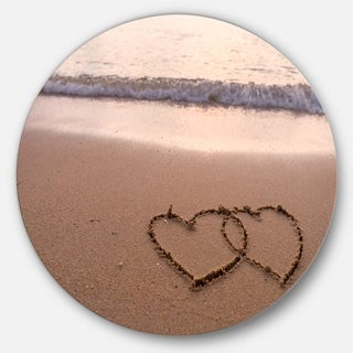 Designart 'Two Hearts Drawn on the Beach' Seascape Disc Metal Artwork