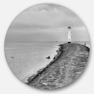 Designart 'Lighthouse Windmill Stawa Mlyny in Grey' Seashore Round Metal Wall Art