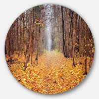 Designart 'Yellow Fallen Leaves in Morning' Landscape Photo Round Wall Art