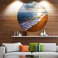 Designart 'Heavy Clouds Over Morning Beach' Seashore Large Disc Metal Wall art