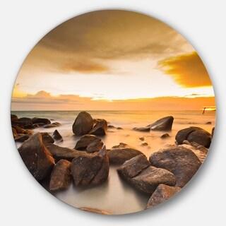 Designart 'Rocky Yellow Tropical Beach' Seashore Disc Metal Wall Art