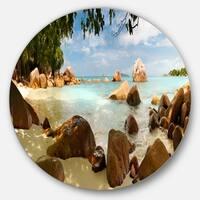 Designart 'Tropical Rocky Beach Panorama' Large Disc Metal Wall art Landscape