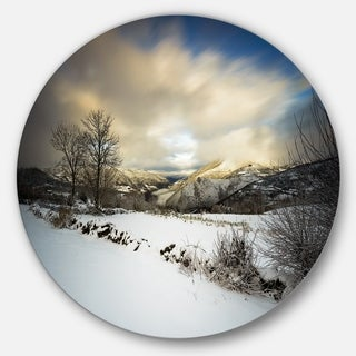 Designart 'Snow Storm in Spain' Landscape Photography Large Disc Metal Wall art