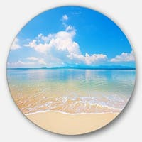 Designart 'Clouds Over Calm Beach' Seashore Photo Circle Wall Art