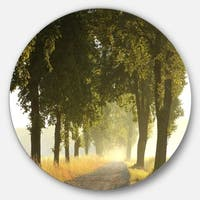 Designart 'Country Road Below Green Trees' Landscape Photo Round Metal Wall Art