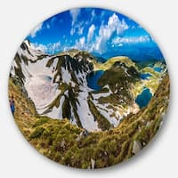 Designart 'Clouds Over Seven Rila Lakes' Landscape Disc Metal Wall Art