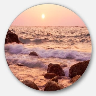 Designart 'Foam Waves Hitting Rocky Coast' Seashore Round Wall Art