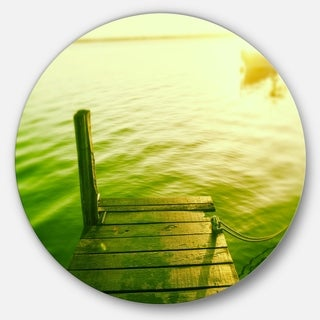 Designart 'Wooden Boardwalk in Green Sea' Sea Bridge Round Wall Art