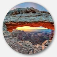 Designart 'Sunrise at Mesa Arch in Canyon lands' Landscape Large Disc Metal Wall art