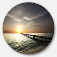Designart 'Long Boardwalk in the Cloudy Dark Sea' Sea Bridge Large Disc Metal Wall art