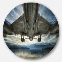 Designart 'Plane Over Beach and Sea' Seashore Photography Large Disc Metal Wall art