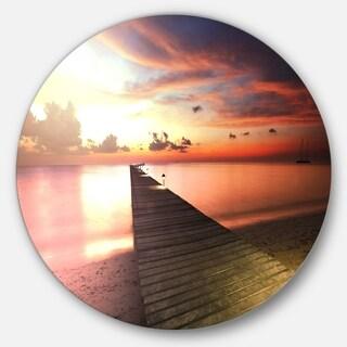 Designart 'Wooden Boardwalk into Colorful Sea' Sea Bridge Disc Metal Wall Art