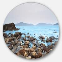 Designart 'Stones on Shore of Port Shelter HK' Seashore Large Disc Metal Wall art