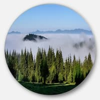 Designart 'Green Trees and Fog Over Mountains' Landscape Round Metal Wall Art