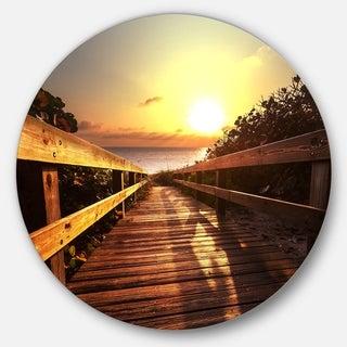 Designart 'Wooden Boardwalk on Beach' Sea Bridge Disc Metal Artwork