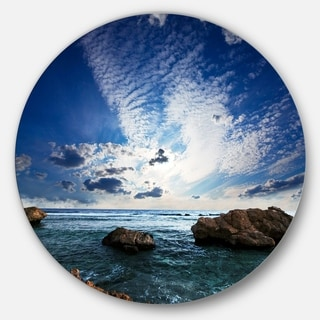 Designart 'Rocky Beach with White Clouds' Modern Beach Circle Wall Art