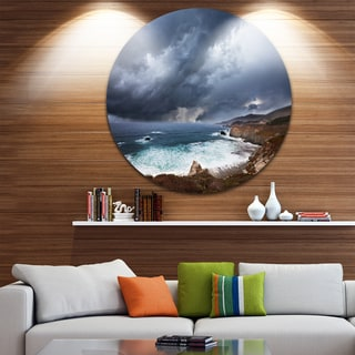 Designart 'Heavy Blue Clouds and Waves' Modern Beach Circle Wall Art