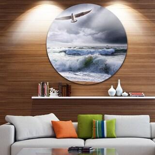 Designart 'Seagull over Stormy Waves' Modern Beach Circle Wall Art