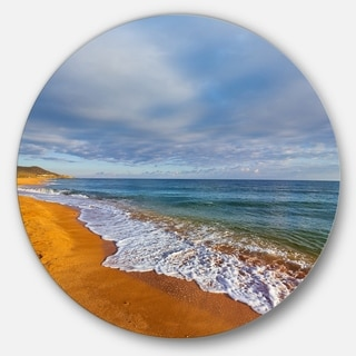 Designart 'Dark Beach under Cloudy Skies' Modern Beach Round Wall Art
