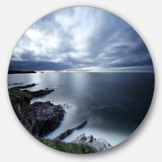 Designart 'Gloomy Bluish Atlantic Beach Portugal' Seashore Circle Wall Art