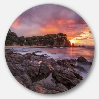 Designart 'Gloomy Seashore with Rocks' Seashore Disc Metal Artwork