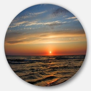 Designart 'Red Sunset with Dark Ocean Waves' Seashore Round Metal Wall Art