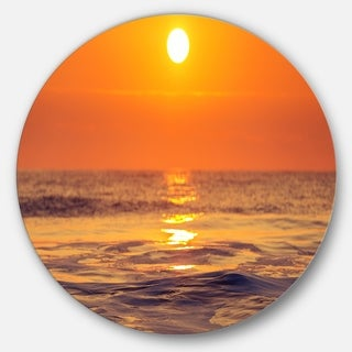 Designart 'Orange Sunrise and Glittering Waters' Seashore Circle Wall Art