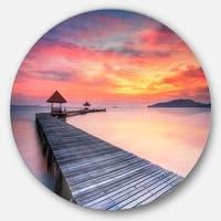 Designart 'Stylish Wooden Bridge and Beach Sky' Sea Pier Large Disc Metal Wall art