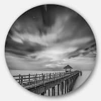Designart 'Black and White Wooden Bridge and Sky' Sea Pier Round Wall Art