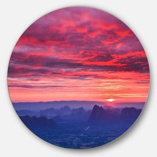 Designart 'Red and Blue Winter Mountains' Landscape Photo Circle Wall Art