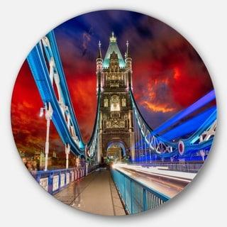 Designart 'Storm Over Tower Bridge at Night' Cityscape Photo Disc Metal Artwork
