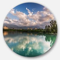 Designart 'City Lake with Cloud Reflection' Cityscape Photo Disc Metal Artwork
