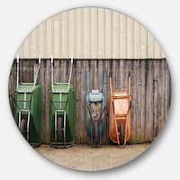Designart 'Row of Wheelbarrows' Landscape Photo Circle Wall Art