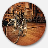 Designart 'Retro Bicycle against Stone Wall' Landscape Photo Round Metal Wall Art