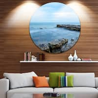 Designart 'Blue Rocky Seashore' Sea and Shore Photo Circle Wall Art