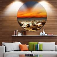 Designart 'Red Sky over Rocky Seashore' Beach Photography Large Disc Metal Wall art
