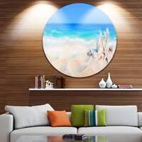 Designart 'Seashells on Seashore' Beach and Shore Photo Circle Metal Artwork