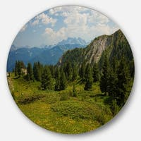 Designart 'Amazing Visitor Mountains' Landscape Photo Round Metal Wall Art