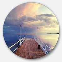 Designart 'Pier Under Bright Sky' Seascape Photo Circle Wall Art