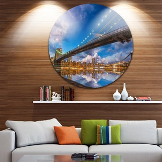 Designart 'Sunset Over Brooklyn Bridge' Cityscape Photo Round Metal Wall Art